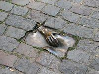 metal hand on the breast street